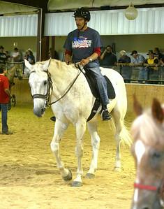 H. Rick Bamman - hbamman@shawmedia.com Air Force veteran Ljdo Corderon performas in the arena at the  Annual BraveHearts Heroes on Horseback horse show.