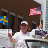 A member of The Good Humor Man Ice Cream Truck float waves the Swedish and American Flags during The Swedish Days Parade in Geneva, IL on Sunday, June 22, 2014 (Sean King for Shaw Media)