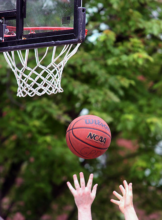 Jeff Krage – For Shaw Media<br /> A player reaches for a rebound during Saturday's 3-on-3 Basketball Tournament at Swedish Days in Geneva.<br /> Geneva 6/21/14