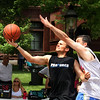 Jeff Krage – For Shaw Media<br /> Hold My Own's Jason Rader of Geneva goes up for a shot while being defended by Team Held's Brian Porter of Batavia during Saturday's 3-on-3 Basketball Tournament at Swedish Days in Geneva. All the players on Hold My Own are Geneva High School graduates. Rader has been playing in the tournament since 1997.<br /> Geneva 6/21/14