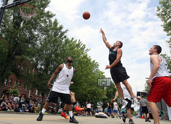 Jeff Krage – For Shaw Media<br /> Pro Martial Arts' Jon Suire of Elgin takes a shot during Saturday's 3-on-3 Basketball Tournament at Swedish Days in Geneva.<br /> Geneva 6/21/14