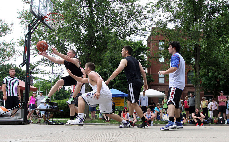 Jeff Krage – For Shaw Media<br /> Players compete in Saturday's 3-on-3 Basketball Tournament during Swedish Days in Geneva.<br /> Geneva 6/21/14