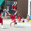 Members of the Jessie White Tumbling Team perform for the crowd during The Swedish Days Parade in Geneva, IL on Sunday, June 22, 2014 (Sean King for Shaw Media)