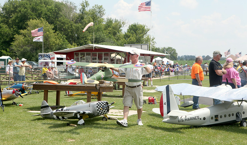 A participant at the Windy City Warbirds event prepares his plane for flight Friday at the Fox Valley Aero Club field in St. Charles. The event runs through today.