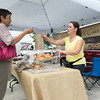 Pam Nass (left) of Sugar Grove, IL purchases 3 scones from Ana Barnat of Amazing Bread and Cakes from Yorkville, IL at The Sugar Grove Farmers Market Sugar Grove Village Hall Parking Lot Rt. 30 & Municipal Drive (10 Municipal Drive) in Sugar Grove, IL on Saturday, June 21, 2014 (Sean King for Shaw Media)