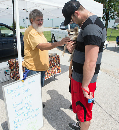 Paul St. John (left) of Sugar Grove, IL greets Steven Hill of Sugar Grove, IL and his long haired Chiwawa Rosco at The Sugar Grove Farmers Market Sugar Grove Village Hall Parking Lot Rt. 30 & Municipal Drive (10 Municipal Drive) in Sugar Grove, IL on Saturday, June 21, 2014 (Sean King for Shaw Media)