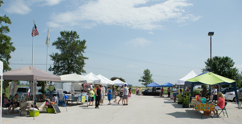 Local area residents browse the various goods for sale <br /> at The Sugar Grove Farmers Market Sugar Grove Village Hall Parking Lot Rt. 30 & Municipal Drive (10 Municipal Drive) in Sugar Grove, IL on Saturday, June 21, 2014 (Sean King for Shaw Media)