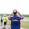 A participant at the Windy City Warbirds event watches a plane in flight Friday at the Fox Valley Aero Club field in St. Charles. The event runs through today.