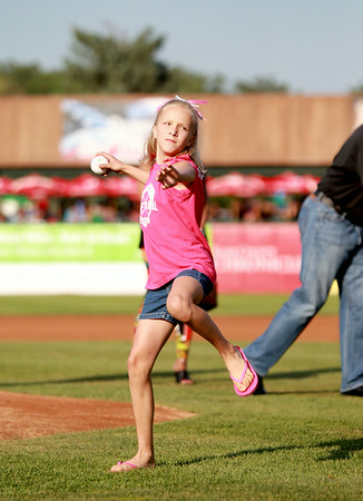 Nine-year-old Lexxi Crossen of St. Charles throws the first pitch before Thursday's Kane County Cougars game against Wisconsin Timber Rattlers on behalf of Shaw Media and the Kane County Chronicle Subscribers Night. Family four-packs of tickets were given to the first 50 subscribers to contact the Chronicle.