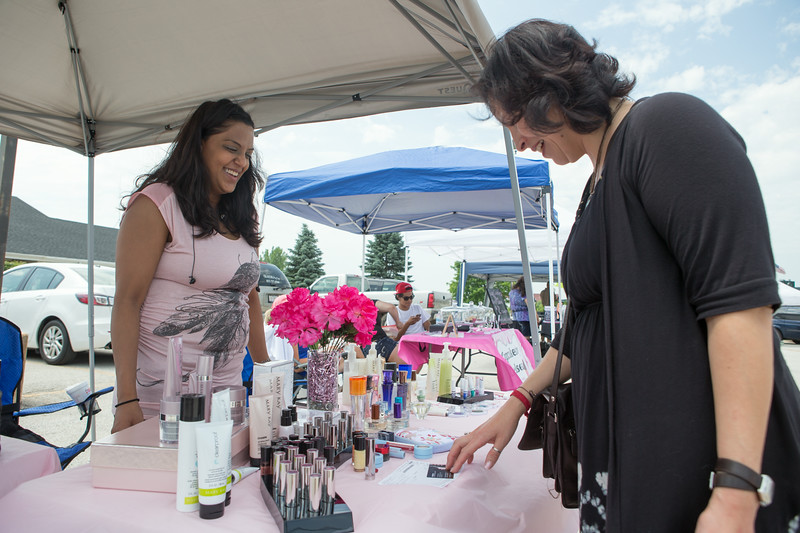 Khadija Khan (Left) of Montgomery offers Mary Kay Products for sale at The Sugar Grove Farmers Market Sugar Grove Village Hall Parking Lot Rt. 30 & Municipal Drive (10 Municipal Drive) in Sugar Grove, IL on Saturday, June 21, 2014 (Sean King for Shaw Media)