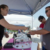 Chelsea Turner of Aurora, IL completes a sale of Cupcakes to Curtis B. from Sugar Grove, IL at The Sugar Grove Farmers Market Sugar Grove Village Hall Parking Lot Rt. 30 & Municipal Drive (10 Municipal Drive) in Sugar Grove, IL on Saturday, June 21, 2014 (Sean King for Shaw Media)