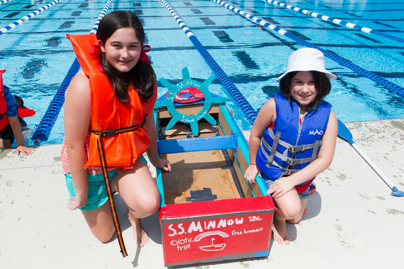 Team SS Minnow's Lily Rooney 12, and her sister Norah 8, take First Place during the Sink or Swim Cardboard Boat Races at Swanson Pool in St. Charles, IL on Saturday, June 28, 2014 (Sean King for Shaw Media)