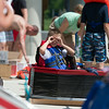 Hollister Schneider 8, of St. Charles checks out the competition prior to the start of the Sink or Swim Cardboard Boat Races at Swanson Pool in St.Charles, IL on Saturday, June 28, 2014 (Sean King for Shaw Media)
