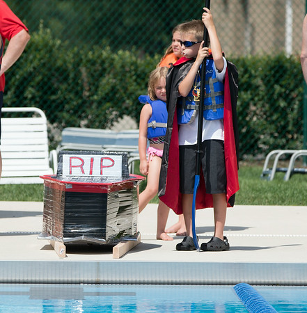 Hollister Schneider 8, of St. Charles gets ready to put his New Life boat into the water during the Sink or Swim Cardboard Boat Races at Swanson Pool in St. Charles, IL on Saturday, June 28, 2014 (Sean King for Shaw Media)