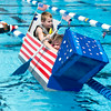 Gunnar Tosaw 7, and his sister Grace 5, from St. Charles work on moving their boat away from a lane line<br /> during the Sink or Swim Cardboard Boat Races at Swanson Pool in St. Charles, IL on Saturday, June 28, 2014 (Sean King for Shaw Media)