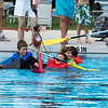 Team Seahorses - Brady Barnes 9, Brett Barnes 11, Anna Buvary 7 and Albert Buvary 10, of St. Charles struggle to keep their boat The SS PillBug afloat during the Sink or Swim Cardboard Boat Races at Swanson Pool in St.Charles, IL on Saturday, June 28, 2014 (Sean King for Shaw Media)