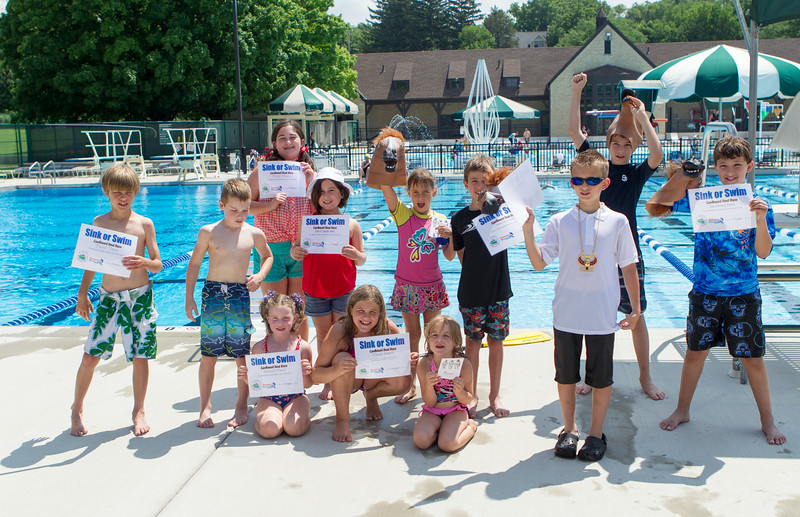Sink or Swim contestants celebrate at the conclusion of the Sink or Swim Cardboard Boat Races at Swanson Pool in St.Charles, IL on Saturday, June 28, 2014 (Sean King for Shaw Media)