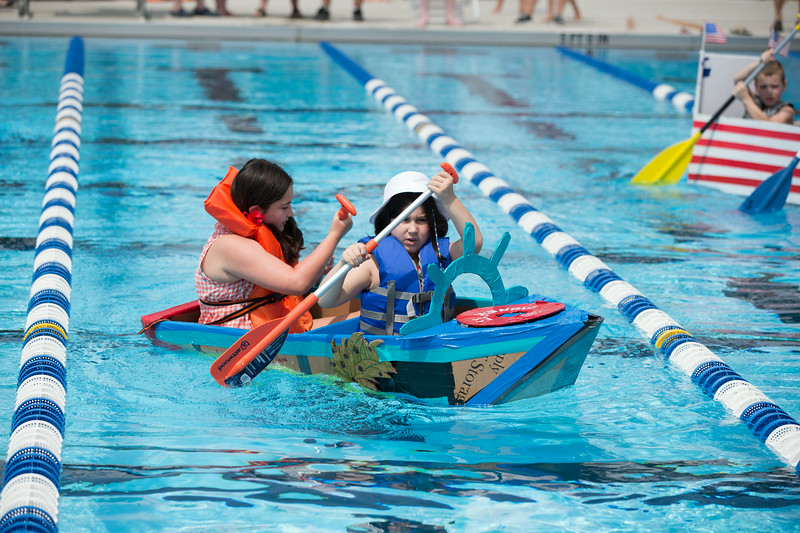 Lily Rooney 12, and her sister Norah 8, of St. Charles successfully navigate their boat the SS Minnow during the Sink or Swim Cardboard Boat Races at Swanson Pool in St. Charles, IL on Saturday, June 28, 2014 (Sean King for Shaw Media)