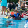 Team Seahorses - Brady Barnes 9, Brett Barnes 11, Anna Buvary 7 and Albert Buvary 10, of St. Charles navigate their boat The SS PillBug during the Sink or Swim Cardboard Boat Races at Swanson Pool in St. Charles, IL on Saturday, June 28, 2014 (Sean King for Shaw Media)