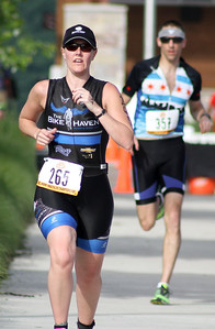 Mike Greene - For Shaw Media Dawn Efflandt, of Barrington, races during the second annual Illinois Championship Triathlon Sunday, June 21, 2015 at the Three Oaks Recreation Area in Crystal Lake.