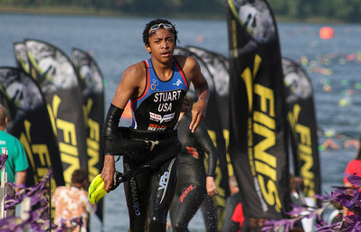 Mike Greene - For Shaw Media Elijah Stuart, of Gilberts, transitions from the swim segment during the second annual Illinois Championship Triathlon Sunday, June 21, 2015 at the Three Oaks Recreation Area in Crystal Lake.
