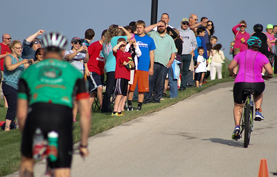 Mike Greene - For Shaw Media Onlookers cheer on competitors during the second annual Illinois Championship Triathlon Sunday, June 21, 2015 at the Three Oaks Recreation Area in Crystal Lake.