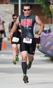 Mike Greene - For Shaw Media Wyatt Mack runs during the second annual Illinois Championship Triathlon Sunday, June 21, 2015 at the Three Oaks Recreation Area in Crystal Lake.