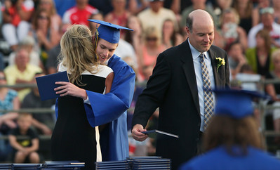 Connor Diedrich gets his diploma and a hug as the Class of 2016 graduates at Johnsburg High School on Friday, June 3, 2016 in Johnsburg.  John Konstantaras photo for the Northwest Herald