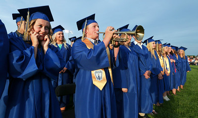 Mikayla Andersen, left, plugs her ears as Alexander Anderson belts out a few notes during Johnsburg High School graduation on Friday, June 3, 2016 in Johnsburg.  John Konstantaras photo for the Northwest Herald