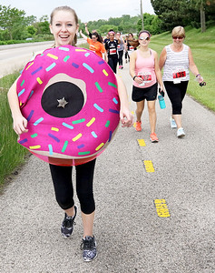 Candace H. Johnson Alicia Lambrecht, 15, of Kenosha, Wis., the official mascot, walks on the path along Washington Street during the Outrun the Cops! & Walk for the Kids at the Gurnee Police Department. Alicia's mother, Juli, works for the Gurnee Police Department.