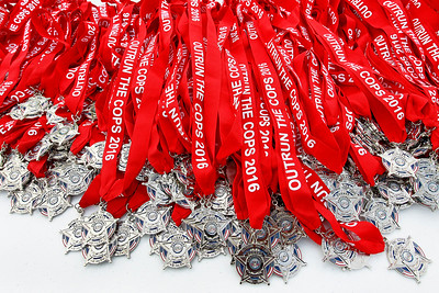 Candace H. Johnson Medals sit on a table to be given out during the Outrun the Cops! & Walk for the Kids race at the Gurnee Police Department.