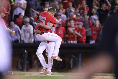 Sarah Nader - snader@shawmedia.com Mundelein's Brett Parola celebrate winning Monday's Class 4A  Supersectional final against Huntley at Boomers Stadium in Schaumburg June 6, 2016. Mundelein won, 8-0.