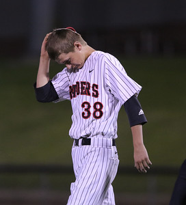 Sarah Nader - snader@shawmedia.com Huntley's Cole Raines walks off the field during Monday's Class 4A  Supersectional final against Mundelein at Boomers Stadium in Schaumburg June 6, 2016. Mundelein won, 8-0.