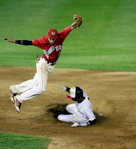 Sarah Nader - snader@shawmedia.com Mundelein's Jake Breitenreiter (left) grabs the ball while  Huntley's Charlie Nugent is out at second during the third inning of Monday's Class 4A  Supersectional final at Boomers Stadium in Schaumburg June 6, 2016. Mundelein won, 8-0.