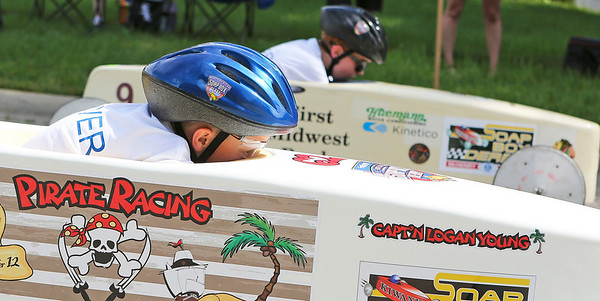 Mike Greene - For Shaw Media  Logan Young, 10 of Algonquin, keeps his head low while racing during the 14th Annual McHenry Kiwanis All-American 2016 Soap Box Derby Saturday, June 11, 2016 in McHenry.