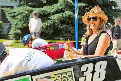 Mike Greene - For Shaw Media  Grand Marshall Suzanne Cannon prepares to release the racers during the 14th Annual McHenry Kiwanis All-American 2016 Soap Box Derby Saturday, June 11, 2016 in McHenry.