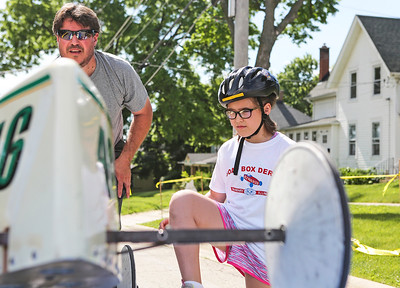 Mike Greene - For Shaw Media  Ava Riske, 10 of McHenry, steps up to the racing platform as her dad Jack keeps the car steady during the 14th Annual McHenry Kiwanis All-American 2016 Soap Box Derby Saturday, June 11, 2016 in McHenry.