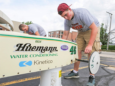 Mike Greene - For Shaw Media  Volunteer Blake Weisenberger, 15 of McHenry, helps swap out wheels during the 14th Annual McHenry Kiwanis All-American 2016 Soap Box Derby Saturday, June 11, 2016 in McHenry.