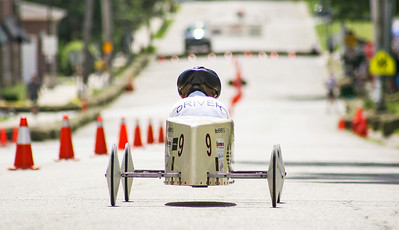 Mike Greene - For Shaw Media  Michael Metz, 11 of McHenry, makes his way down the hill during the 14th Annual McHenry Kiwanis All-American 2016 Soap Box Derby Saturday, June 11, 2016 in McHenry.