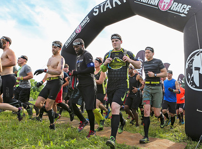 Mike Greene - For Shaw Media  Participants take off from the starting line during the Spartan Race: Chicago Super 2016 Saturday, June 11, 2016 at the Richmond Hunt Club in Richmond.