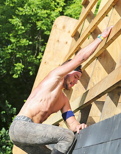 Mike Greene - For Shaw Media  Second place elite finisher Brian Gowiski focuses on an obstacle during the Spartan Race: Chicago Super 2016 Saturday, June 11, 2016 at the Richmond Hunt Club in Richmond.