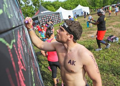 Mike Greene - For Shaw Media  Patrick McDermott, of Chicago, signs the chalk board before competing in the Spartan Race: Chicago Super 2016 Saturday, June 11, 2016 at the Richmond Hunt Club in Richmond.