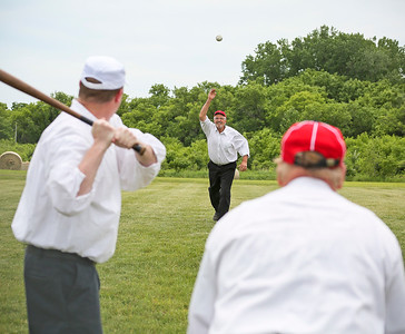 "Mike Greene - For Shaw Media  McHenry County Independants' Jim ""Hillbilly"" Holsten, of Crystal Lake, pitches to Grayslake Athletics' Kevin ""Poppy"" DeBolt, of Round Lake Beach"" during a Civil War-era baseball game Sunday, June 12, 2016 at Village Hall Park in Prairie Grove."