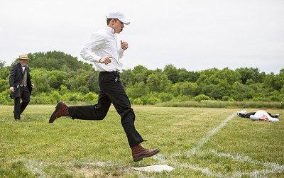 """Mike Greene - For Shaw Media  McHenry County Independants' Haden """"Mini Muffin"""" Tipps, of Walworth Wisconsin, crosses home plate winning the fleet of foot contest before the start of a Civil War-era baseball game against the Grayslake Athletics Sunday, June 12, 2016 at Village Hall Park in Prairie Grove."""