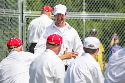 """Mike Greene - For Shaw Media  McHenry County Independants' Gus """"The Machine"""" Tipps, of Walworth Wisconsin, celebrates with teammates after scoring during a Civil War-era baseball game against the Grayslake Athletics Sunday, June 12, 2016 at Village Hall Park in Prairie Grove."""