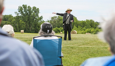 Mike Greene - For Shaw Media  Grayslake Heritage Center Executive Director Dave Oberg explains the rules of the game before the start of  a Civil War-era baseball game between the McHenry County Independants and the Grayslake Athletics Sunday, June 12, 2016 at Village Hall Park in Prairie Grove.