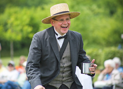 Mike Greene - For Shaw Media  Grayslake Heritage Center Executive Director Dave Oberg laughs while explaining phrases of the day during a Civil War-era baseball game between the McHenry County Independants and the Grayslake Athletics Sunday, June 12, 2016 at Village Hall Park in Prairie Grove.