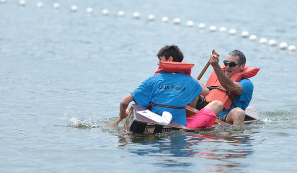 Michelle LaVigne/ For Shaw Media Das Boot makes a recovery after a minor upset into the water as Ashton Gambrel and Chris Lombardo with Kenmore Tool and Engineering out of Algonquin make their way to the finish line during the 32nd annual America's Cardboard Cup Regatta June 18 at the Crystal Lake Park District's Main Beach.