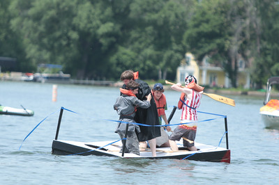 Michelle LaVigne/ For Shaw Media As a part of their RAW wrestling-themed boat, Ben Kaiser and James Boerschinger battle it out in front of Maxwell Blome and Dylan Batton, all of Crystal Lake during the 32nd annual America's Cardboard Cup Regatta June 18 at the Crystal Lake Park District's Main Beach.