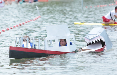 "Michelle LaVigne/ For Shaw Media Molly and Brian Barrett of East Dundee and members of A Bigger Boat, named for the reference to the movie ""Jaws,"" walk their boat to the finish line after capsizing."